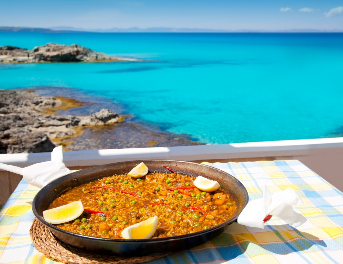 'Paella mediterranean rice food by the Balearic Formentera island beach [ photo-illustration]' - Formentera